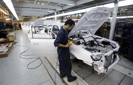 A man works in an assembly line of Hyundai cars in Egypt's biggest car assembler GB Auto in Cairo September 10, 2013. REUTERS/Mohamed Abd El Ghany