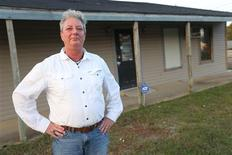 """Pat """"P.J."""" Newton stands in front of the building she is leasing in Shannon, Mississippi September 30, 2012. REUTERS/Lauren Wood"""
