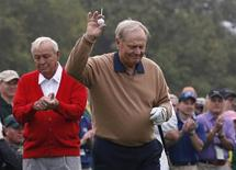 Jack Nicklaus of the U.S. (R) is applauded by Arnold Palmer of the U.S. as he is introduced during the ceremonial start for the 2013 Masters golf tournament at the Augusta National Golf Club in Augusta, Georgia, April 11, 2013. REUTERS/Mike Segar