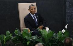 U.S. President Barack Obama takes his seat after arriving to address the 68th United Nations General Assembly at UN headquarters in New York, September 24, 2013. REUTERS/Mike Segar