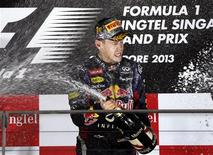 Red Bull Formula One driver Sebastian Vettel of Germany sprays champagne on the podium after winning the Singapore F1 Grand Prix at the Marina Bay street circuit in Singapore September 22, 2013. REUTERS/Pablo Sanchez