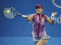 Li Na of China returns a shot against Sabine Lisicki of Germany during their match at the China Open tennis tournament in Beijing October 2, 2013. REUTERS/Kim Kyung-Hoon