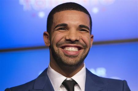 Rapper Drake smiles during an announcement that the Toronto Raptors will host the NBA All-Star game in Toronto, September 30, 2013. REUTERS/Mark Blinch