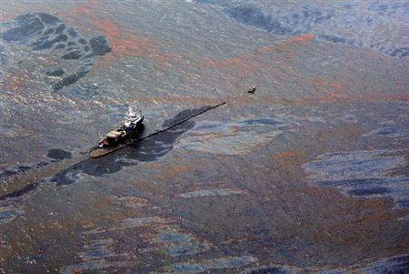 Oil floats on the surface of the Gulf of Mexico around a work boat at the site of the Deepwater Horizon oil spill in the Gulf of Mexico June 2, 2010. REUTERS/Sean Gardner