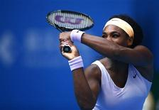 Serena Williams of the U.S. returns the ball during her women's singles match against Maria Kirilenko of Russia at the China Open tennis tournament in Beijing October 3, 2013. REUTERS/Petar Kujundzic