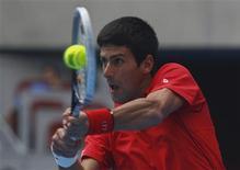 Novak Djokovic of Serbia returns a shot during his match against Fernando Verdasco of Spain at the China Open tennis tournament in Beijing October 3, 2013. REUTERS/Petar Kujundzic