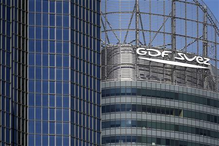The logo of French group GDF Suez is seen on a building in the financial district of La Defense, near Paris August 1, 2013. REUTERS/Benoit Tessier