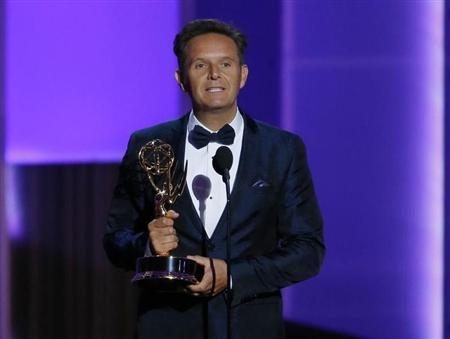 Producer Mark Burnett accepts the award for Outstanding Reality - Competition Program for ''The Voice'' at the 65th Primetime Emmy Awards in Los Angeles September 22, 2013. REUTERS/Mike Blake