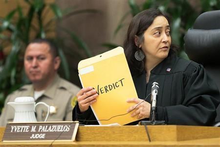 Superior Court Judge Yvette M. Palazuelos gathers the verdict documents moments before they are publicly disclosed in the Katherine Jackson v. AEG Live civil lawsuit at the Los Angeles Superior Court in Los Angeles, October 2, 2013. REUTERS/Robert Gauthier/Pool