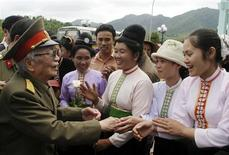 Vietnamese local minority women greet General Vo Nguyen Giap during a visit to the historic Dien Phu military headquarters building in Muong Phang, Dien Bien province in this April 19, 2004 file photo. REUTERS/Kham/Files