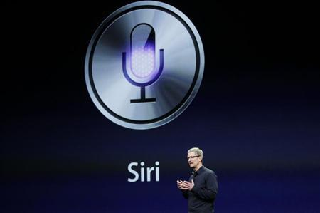 CEO Tim Cook talks about Siri during an Apple event in San Francisco, California March 7, 2012. REUTERS/Robert Galbraith