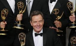 "Actor Bryan Cranston from AMC's series ""Breaking Bad"" poses backstage with his award for Outstanding Drama Series at the 65th Primetime Emmy Awards in Los Angeles September 22, 2013. REUTERS/Lucy Nicholson"