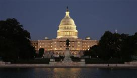 The U.S. Capitol is seen at night on the eve of a potential federal government shutdown, in Washington September 30, 2013. REUTERS/Kevin Lamarque