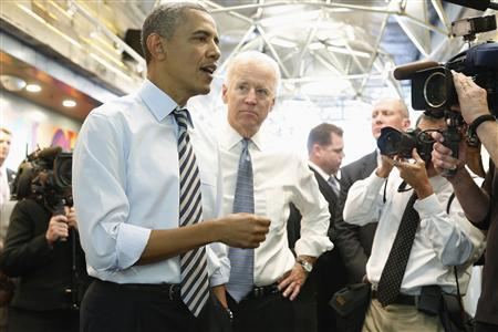 U.S. President Barack Obama (L) and Vice President Joe Biden (2nd L) talk to reporters before ordering at a sandwich shop near the White House in Washington, October 4, 2013. REUTERS/Jonathan Ernst