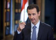 الرئيس السوري بشار الأسد في دمشق يوم الجمعة (صورة لرويترز تستخدم في الأغراض التحريرية فقط ويحظر بيعها او استخدامها في الحملات الدعائية او التسويقية)