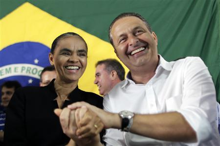 Former Senator Marina Silva (L) reacts with Pernambuco state Governor Eduardo Campos during a meeting where Silva announced her decision to join the Brazilian Socialist Party (PSB), in Brasilia October 5, 2013. REUTERS / Ueslei Marcelino