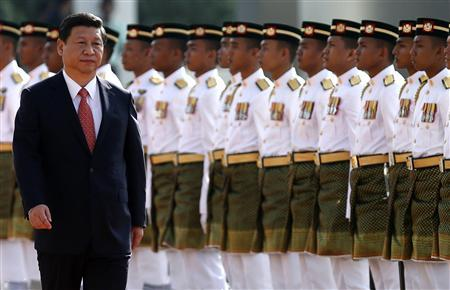 China's President Xi Jinping inspects an honour guard during the state welcoming ceremony at the Parliament house in Kuala Lumpur October 4, 2013. REUTERS/Samsul Said