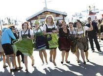 Young women (L-R) Carola, Anne, Tanja, Patrizia, Lena and Lisa from Baden-Wuerttemberg pose while wearing traditional Bavarian dirndls at Munich's 180th Oktoberfest October 3, 2013. REUTERS/Michaela Rehle