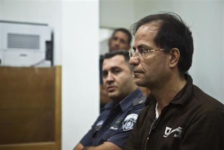 Iranian-Belgian citizen Ali Mansouri sits in a courtroom at the magistrate's court in Petah Tikva near Tel Aviv September 30, 2013. REUTERS/Nir Elias