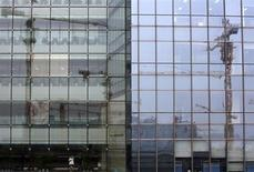 A Pékin. La Banque mondiale a abaissé lundi ses projections de croissance économique pour 2013 et 2014 en Chine et dans la plupart des pays en développement d'Asie de l'Est, du fait du ralentissement de l'activité chinoise et du recul des cours des matières premières. /Photo prise le 1er août 2013/REUTERS/Kim Kyung-Hoon