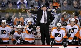 Philadelphia Flyers head coach Peter Laviolette instructs his team against the Winnipeg Jets during the third period of their NHL hockey game in Winnipeg in this file February 21, 2012 photo. REUTERS/Fred Greenslade