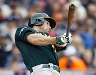 Oct 7, 2013; Detroit, MI, USA; Oakland Athletics designated hitter Seth Smith (15) hits a two-run home run in the fifth inning against the Detroit Tigers in game three of the American League divisional series playoff baseball game at Comerica Park. Rick Osentoski-USA TODAY Sports