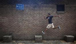 Rashaad Gomez practises parkour in a park in New York October 7, 2013. REUTERS/Carlo Allegri