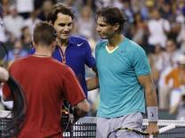 Roger Federer of Switzerland and Rafael Nadal (R) of Spain greet each other at the net after Nadal defeated Federer in their men's singles quarterfinal match at the BNP Paribas Open ATP tennis tournament in Indian Wells, California, March 14, 2013. REUTERS/Danny Moloshok