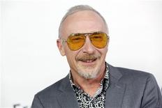 """Singer Graham Parker arrives at the premiere of the movie """"This is 40"""" at Grauman's Chinese Theatre in Hollywood, California in this December 12, 2012 file photo. REUTERS/Patrick T. Fallon/Files"""