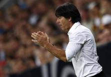 Germany's coach Joachim Loew gestures during their 2014 World Cup qualifying soccer match against Austria in Munich September 6, 2013. REUTERS/Michael Dalder