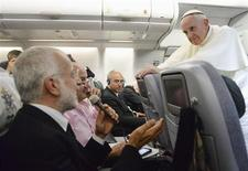 Pope Francis listens to a journalist's question as he flies back to Rome following his visit to Brazil July 29, 2013. REUTERS/Luca Zennaro/Pool