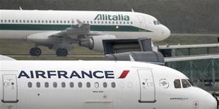 An Alitalia plane passes an Air France plane on the tarmac of Charles de Gaulles International Airport in Roissy near Paris, January 8, 2013. REUTERS/Charles Platiau