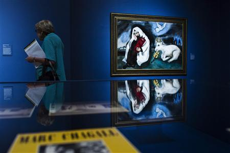 A Visitor Walks Past Painting By Artist Marc Chagall Titled Solitude At The Love War And Exile Exhibition Jewish Museum In New York