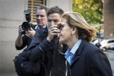 Joann Crupi, who managed clients' investment accounts for Bernard L. Madoff Investment Securities LLC, arrives at the Manhattan Federal Court house in New York October 8, 2013. REUTERS/Brendan McDermid