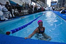 U.S. long-distance swimmer Diana Nyad takes a breath during her 48 hour continuous swim at Herald Square in New York October 8, 2013. REUTERS/Eduardo Munoz