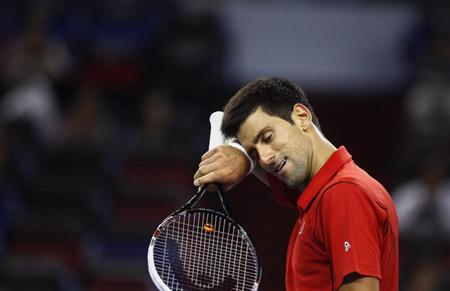Novak Djokovic of Serbia reacts after winning a point during his men's singles tennis match against Marcel Granollers of Spain at the Shanghai Masters tennis tournament in Shanghai October 9, 2013. REUTERS/Carlos Barria