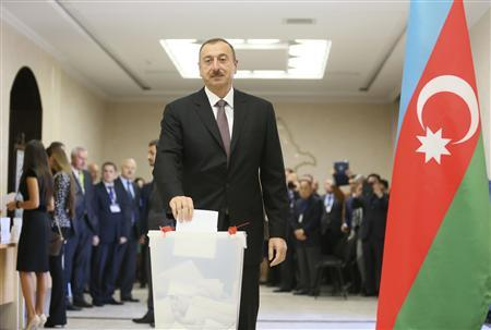 Azerbaijan President Ilham Aliyev casts his vote in the presidential election at a polling station in Baku October 9, 2013. REUTERS/Stringer