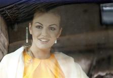 Silvio Berlusconi's girlfriend Francesca Pascale is seen through a car window as she arrives at Grazioli palace, downtown Rome June 25, 2013. REUTERS/Tony Gentile