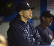 New York Yankees manager Joe Girardi watches from the dugout in the ninth inning of their American League MLB baseball game against the Toronto Blue Jays in Toronto September 19, 2013. REUTERS/Fred Thornhill
