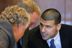 Aaron Hernandez (R), former player for the NFL's New England Patriots football team, talks to defense attorneys Michael Fee (L) and Charles Rankin during a court appearance at the Bristol County Superior Court in Fall River, Massachusetts October 9, 2013, in connection with the death of semi-pro football player Odin Lloyd in June. REUTERS/Brian Snyder