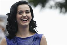 """Singer Katy Perry, who voices the character of """"Smurfette"""", smiles at the premiere of """"The Smurfs 2"""" at the Regency Village theatre in Los Angeles, California July 28, 2013. REUTERS/Mario Anzuoni"""