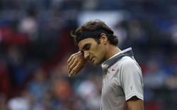 Roger Federer of Switzerland reacts after losing a point during his men's singles tennis match against Gael Monfils of France at the Shanghai Masters tennis tournament in Shanghai October 10, 2013. REUTERS/Aly Song