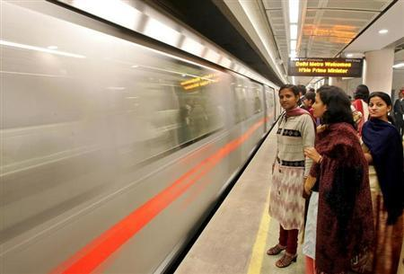 Guest wait to board the underground metro train in New Delhi, December 19, 2004. REUTERS/Kamal Kishore/Files