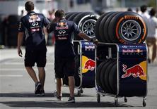 Red Bull Formula One team members move Pirelli tires near the pits at the Suzuka circuit in Suzuka October 10, 2013, ahead of Sunday's Japanese F1 Grand Prix. REUTERS/Issei Kato