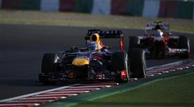Red Bull Formula One driver Sebastian Vettel of Germany drives during the second practice session of the Japanese F1 Grand Prix at the Suzuka circuit October 11, 2013. REUTERS/Issei Kato