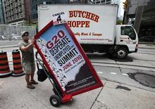 A man holds a sign regarding unemployment on the street in Toronto, in this June 22, 2010 file photo. REUTERS/Mark Blinch