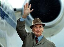 Former German Nazi SS officer Erich Priebke waves to the members of the media as he boards a plane to be extradited to Italy to face a war crimes trial, in Bariloche, southern Argentina in this November 20, 1995 file photo. REUTERS/ Enrique Marcarian/Files