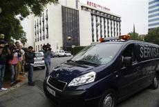 The body of Maria de Villota, former Marussia Formula One test driver, is taken away after she was found dead in a hotel in Seville October 11, 2013. REUTERS/Stringer