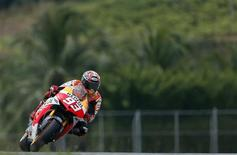 Honda Moto GP rider Marc Marquez of Spain takes a curve during the qualifying session of the Malaysian Motorcycle Grand Prix at Sepang circuit outside Kuala Lumpur October 12, 2013. REUTERS/Samsul Said