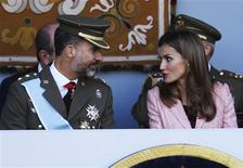 Spain's Crown Prince Felipe (L) and Spain's Princess Letizia attend a military parade marking Spain's National Day in Madrid October 12, 2013. REUTERS/Juan Medina